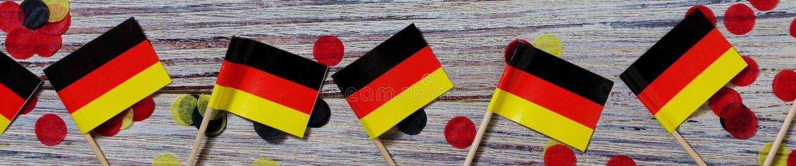 October 3, happy German independence Day. the concept of patriotism , freedom and independence. Mini paper flags with yellow and. Day of German Unity written in stock photo