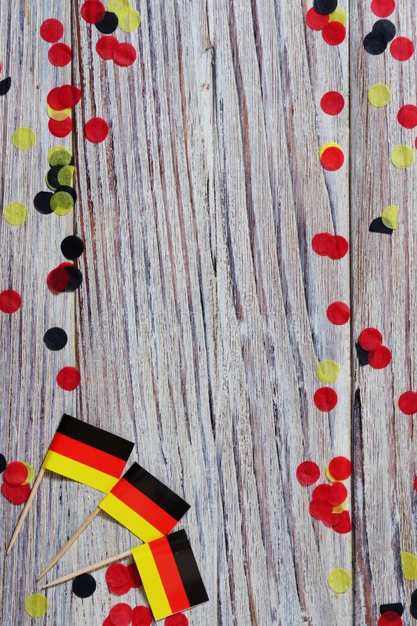 October 3, happy German independence Day. the concept of patriotism , freedom and independence. Mini paper flags with confetti on. Day of German Unity written in stock photo