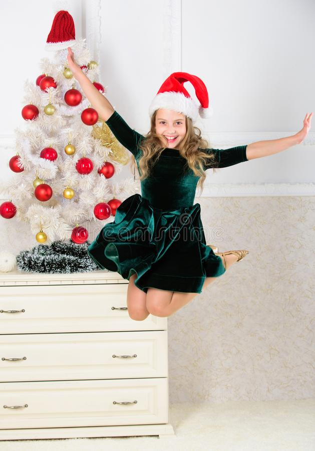 Day we have waited for all year finally here. Girl excited about christmas jump mid air. Child emotional cant stop her royalty free stock image