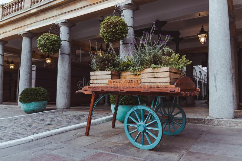 Wood wagon filled with flowers in covent garden london stock photos