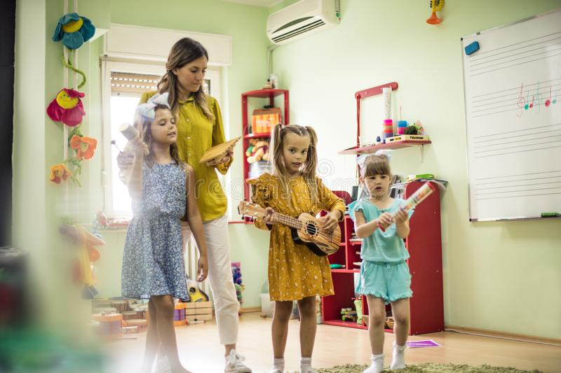 Day for music. Children in preschool royalty free stock image