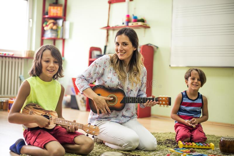 Day with music. Children in preschool royalty free stock photography