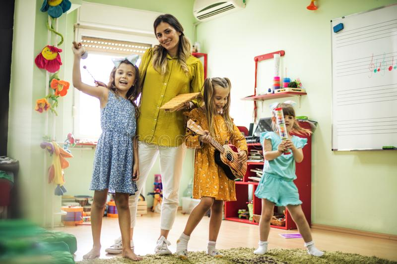 Day for music. Children in preschool royalty free stock photo