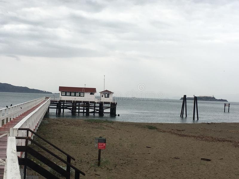 Down the pier, United States Coast Guard lifeboat station, Presidio San Francisco. During day or night and through all kids of weather, the brave young men of stock photography