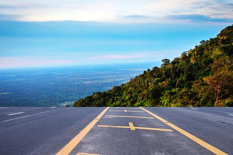 The highway leads to the mountains in the morning royalty free stock image