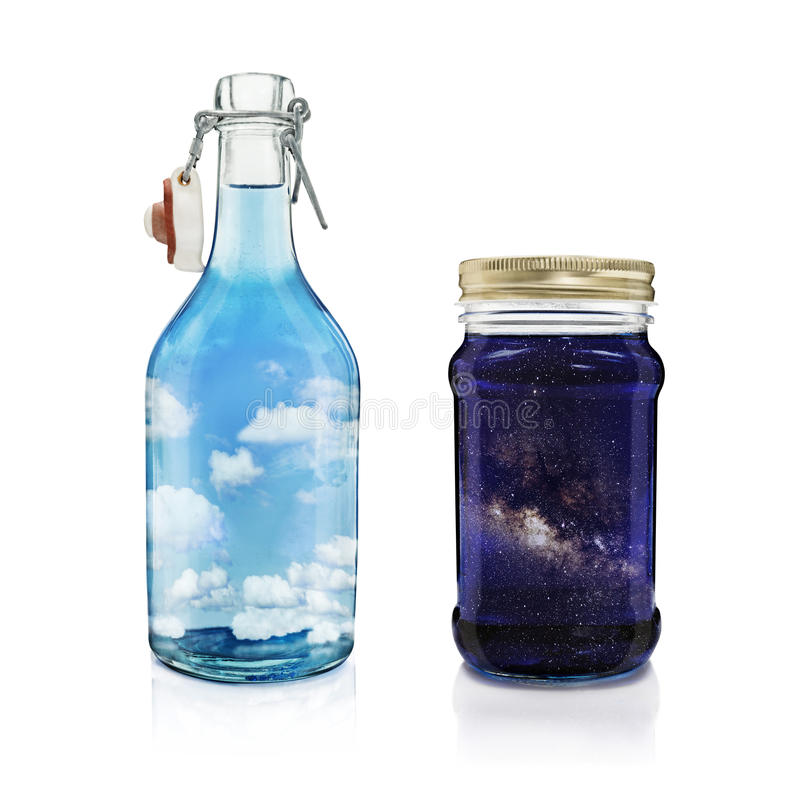 Day and Night. Isolated open bottle filled with daylight sky and clouds on white background, standing next to a isolated closed jar filled with night sky and the stock photography