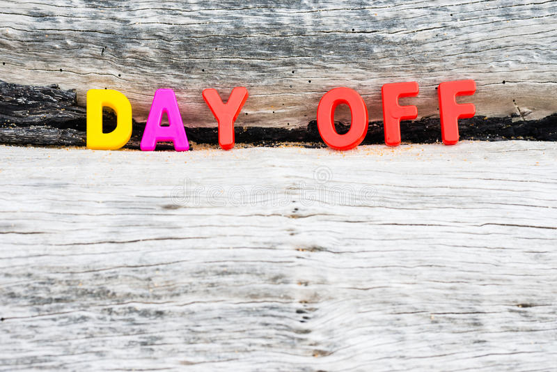 DAY OFF words on wood background royalty free stock image