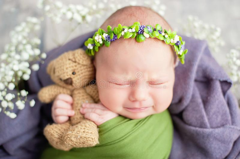 10 day old newborn baby is sleeping in basket. Two week old child. Beginning of life and happy fairy magic childhood concept. Upset child, asleep, beautiful stock images