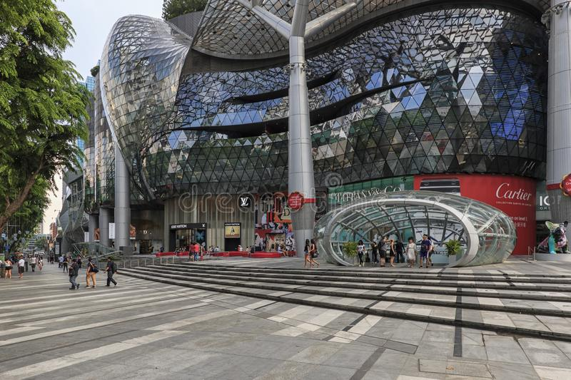 Day scene of ION Orchard shopping mall with several tourists walking by stock images