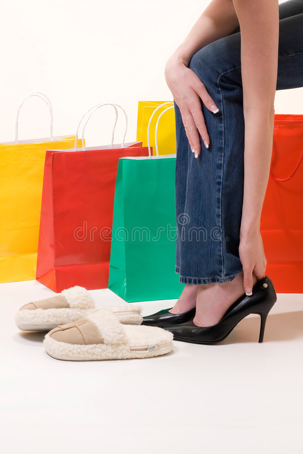 After a day of shopping. Tired legs of a woman from shopping royalty free stock image