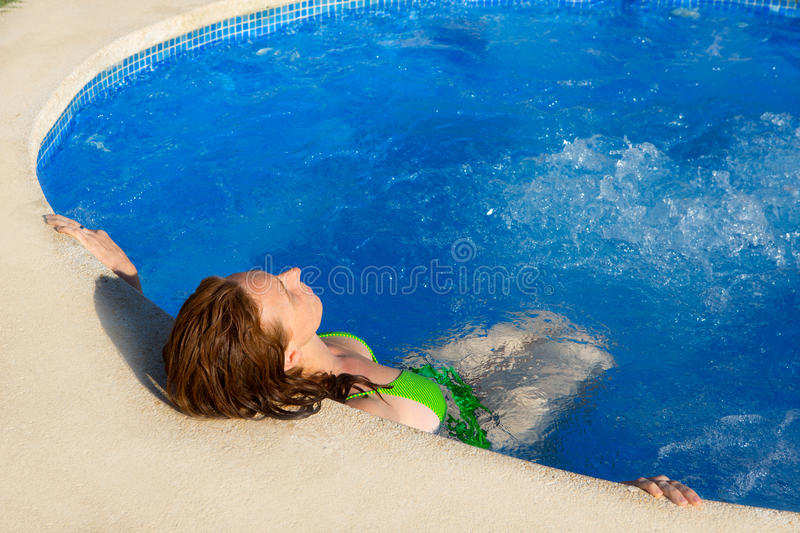 Day spa outdoor woman relaxed on blue pool stock photos