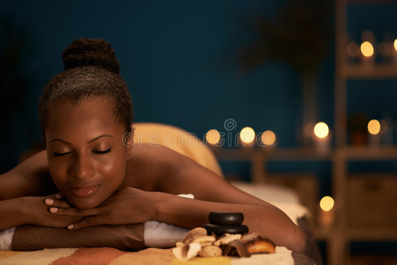 Day in spa salon. Lovely African-American woman spending her day in spa salon