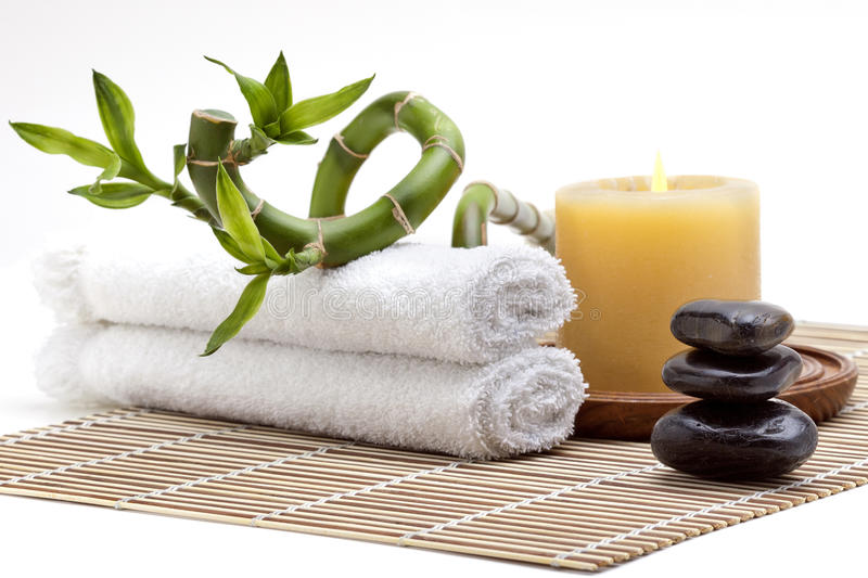 Day spa setting. With zen stones and bamboo plant stock photo