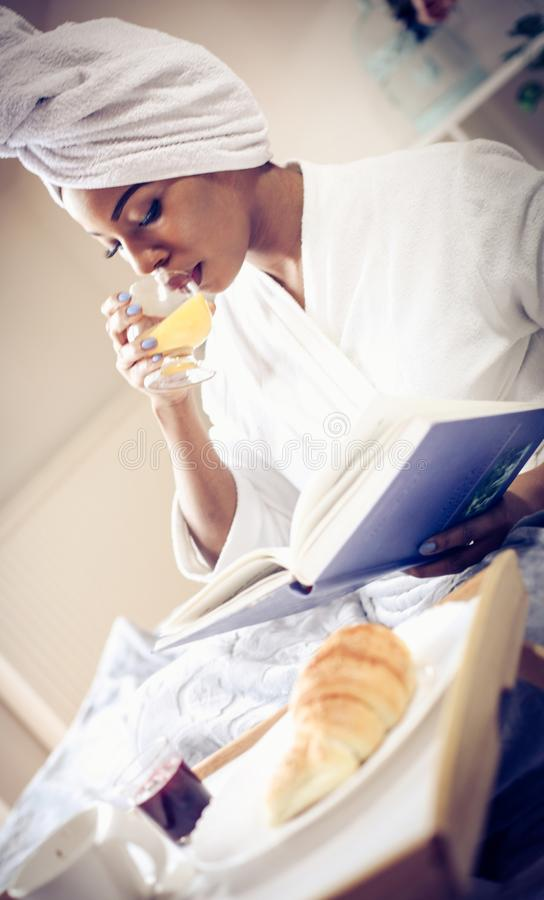 Day starting with breakfast and good book. stock photos