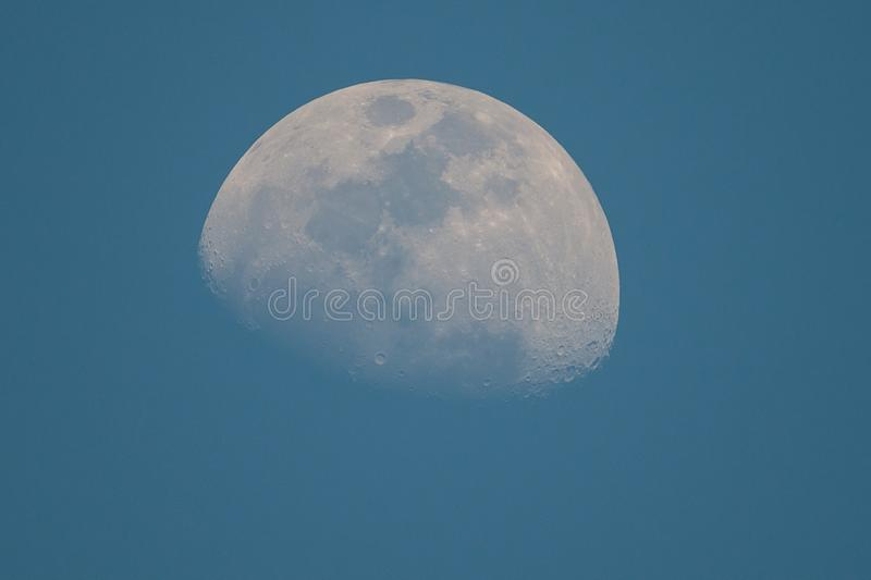Day time moon stock images