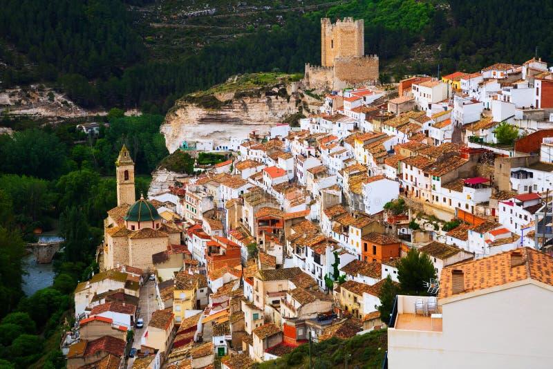 Day view of Alcala del Jucar with castle. Castile-La Mancha, Spain royalty free stock photo