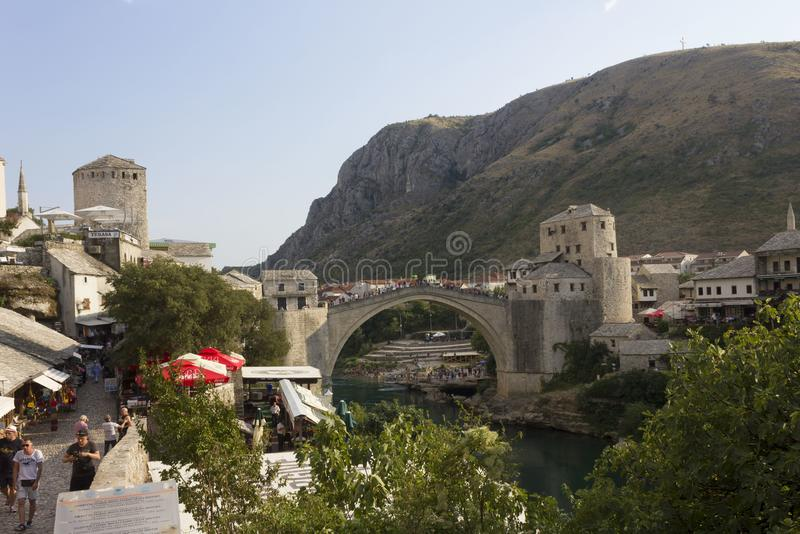 Day view of Stari Most famous bridge in Mostar, with people around stock image