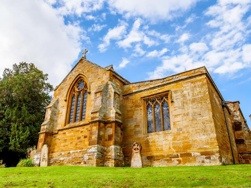 Day view typical Old English Church building over blue sky stock photography
