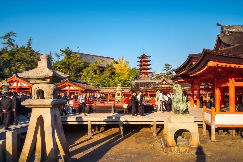A day visit to Itsukushima Shrine at Miyajima Island, Japan. Miyajima Island, Hiroshima, Japan -November 7, 2018: People visiting centuries-old Itsukushima stock photography