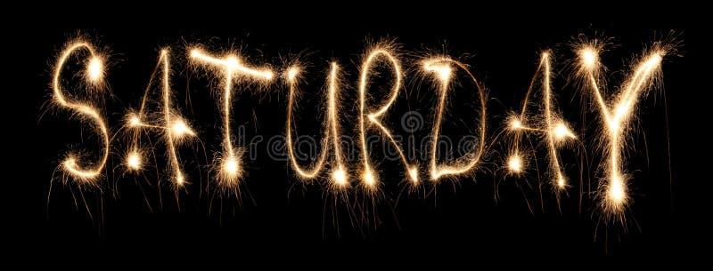 Day of week Saturday it is written sparkler. On dark stock photography