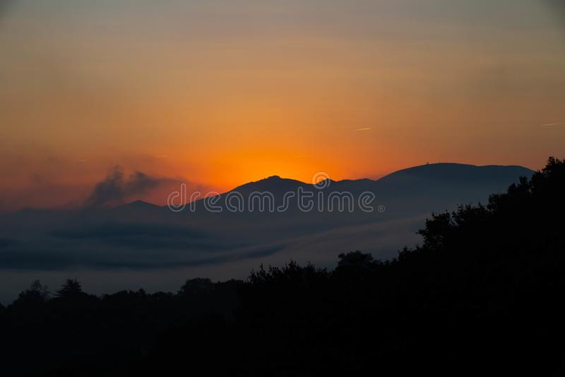Daybreak Basque Country. Daybreak on the Basque mountains with orange yellow radiation announcing the coming arrival of the sun royalty free stock image