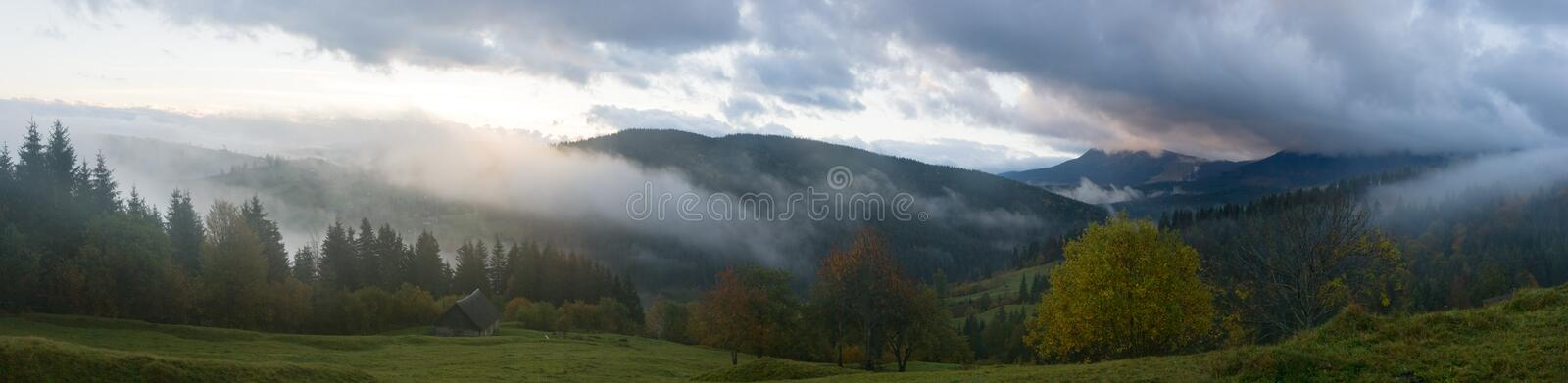 Daybreak in mountain. Misty early daybreak in autumn Carpathian mountain, Ukraine. Ten shots stitch image royalty free stock images