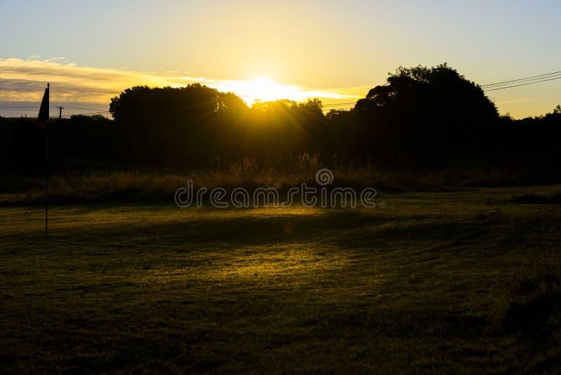 Daybreak Sunrise Over Golf Course, Autumnal morning. royalty free stock photo