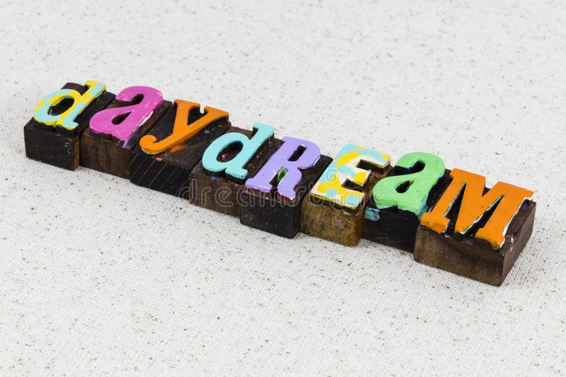 Daydream harmony vision day dream imagination idea happiness. Daydream believer harmony vision day dream imagination idea happiness letterpress phrase quote royalty free stock photography