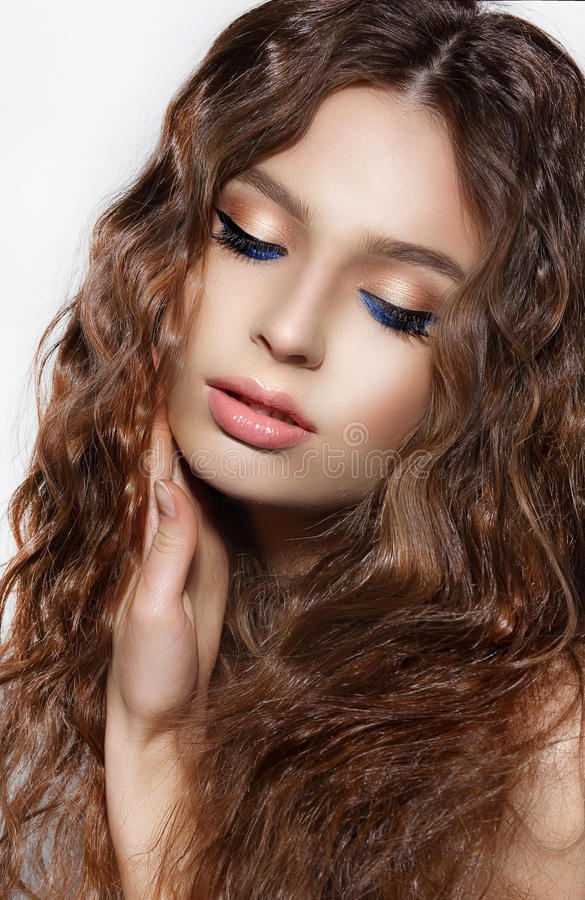 Free Daydreaming Brunette With Curly Hair And Blue Eyeshadows Royalty Free Stock Photo - 42772695