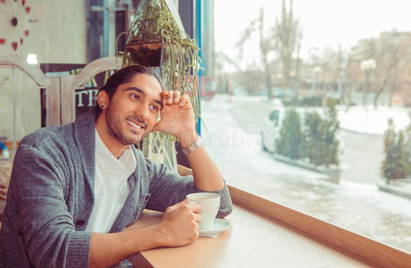 Daydreaming on a coffee break. Pensive happy man thinking stock photos