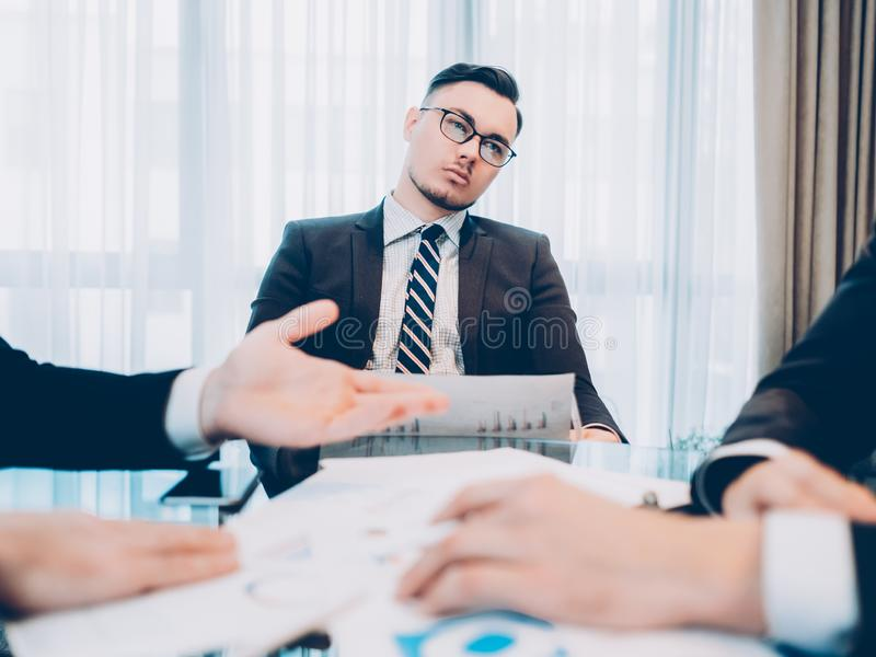 Daydreaming job unmotivated male employee meeting. Daydreaming at work. Distracted, unmotivated male employee feeling bored at corporate meeting stock photography