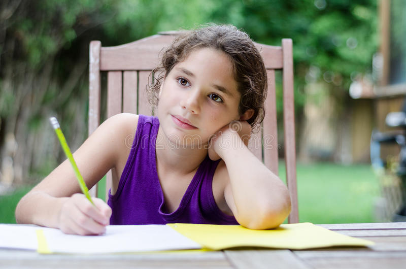 Daydreaming little girl stock images