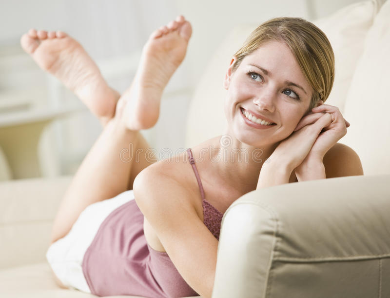 Daydreaming Woman on Couch royalty free stock image