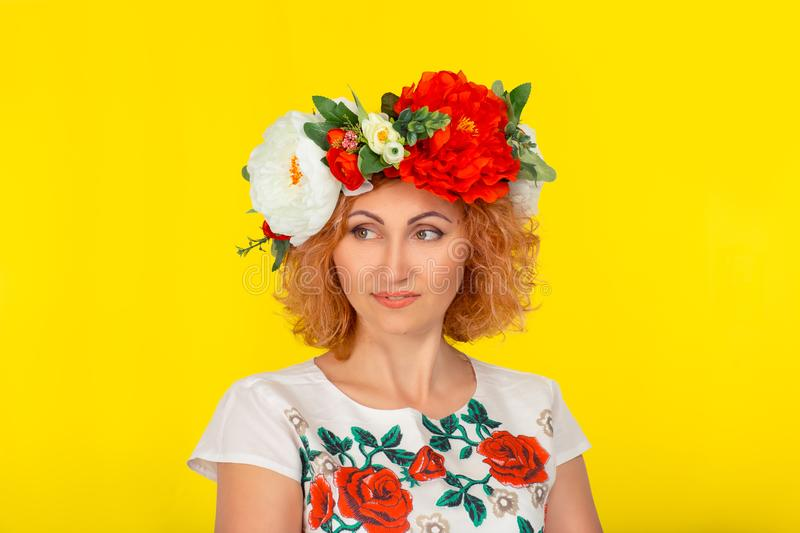 Daydreaming woman with a floral headband from red and white peony royalty free stock image