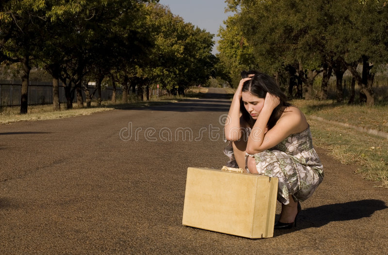 Daydress Next To Suitcase Royalty Free Stock Photos