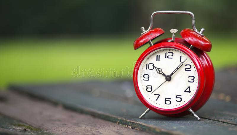 Daylight savings time - banner of a red alarm clock royalty free stock images