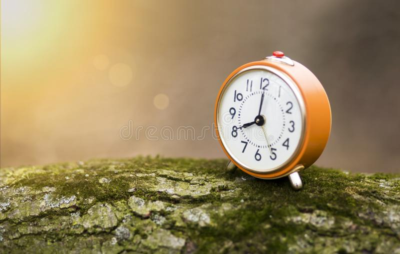 Daylight savings time concept in autumn stock images