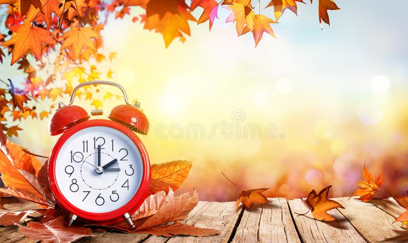 Daylight Savings Time Concept - Clock And Leaves royalty free stock images
