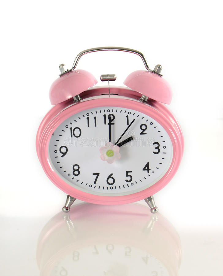 Daylight savings time pink clock royalty free stock photography