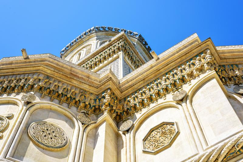 Daylight view from bottom to ornamented monastery facade stock images