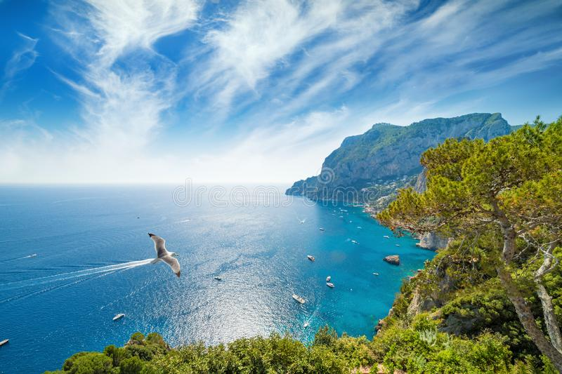 Daylight view of Marina Piccola and Monte Solaro, Capri Island, Italy. Sunny summer weather, blue sea and sky with white clouds stock image