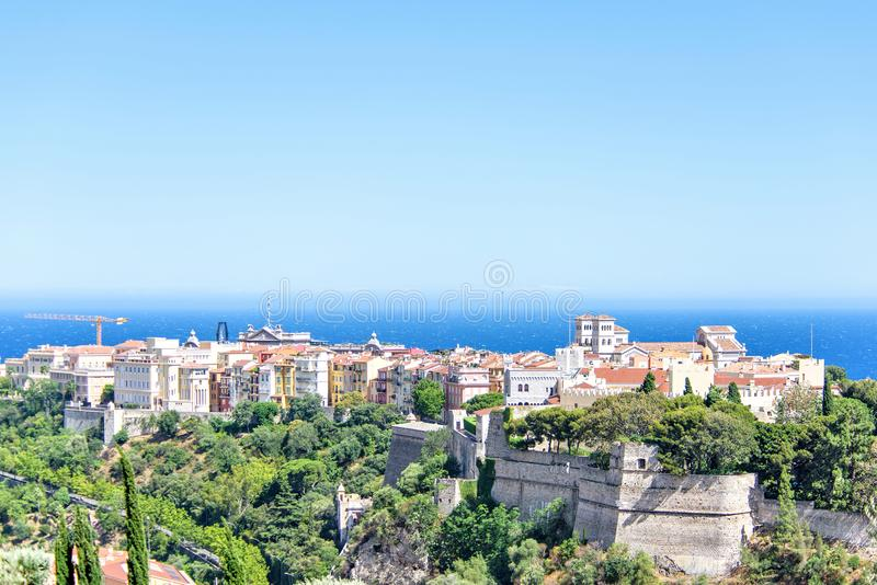 Daylight view to old town with Chateau Grimaldi palace. Cathedral, oceanography museum, apartments and hotels. Bright blue clear sky. Negative copy space stock image