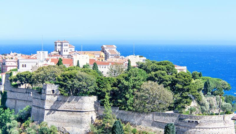 Daylight view to old town with Chateau Grimaldi palace. Cathedral and oceanography museum. Bright blue clear sky and green trees. Negative copy space, place stock image