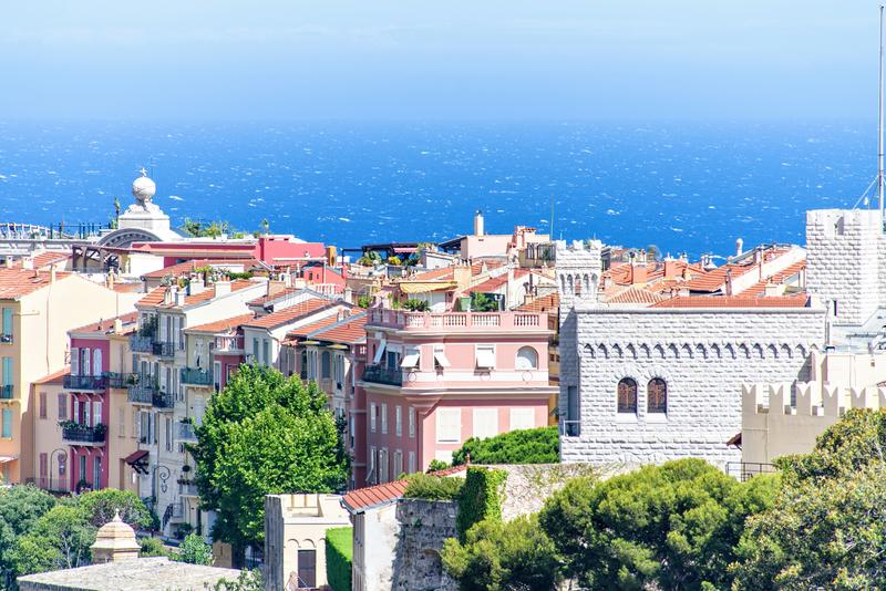 Daylight view to old town with Chateau Grimaldi palace, vintage. Apartments and hotels. Bright blue clear sky. Negative copy space, place for text. Monte Carlo royalty free stock images