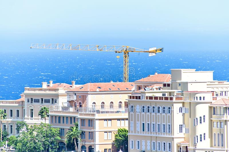 Daylight view to old town with oceanography museum, apartments a. Daylight view to old town with oceanography museum, construction crane, green trees, apartments stock image