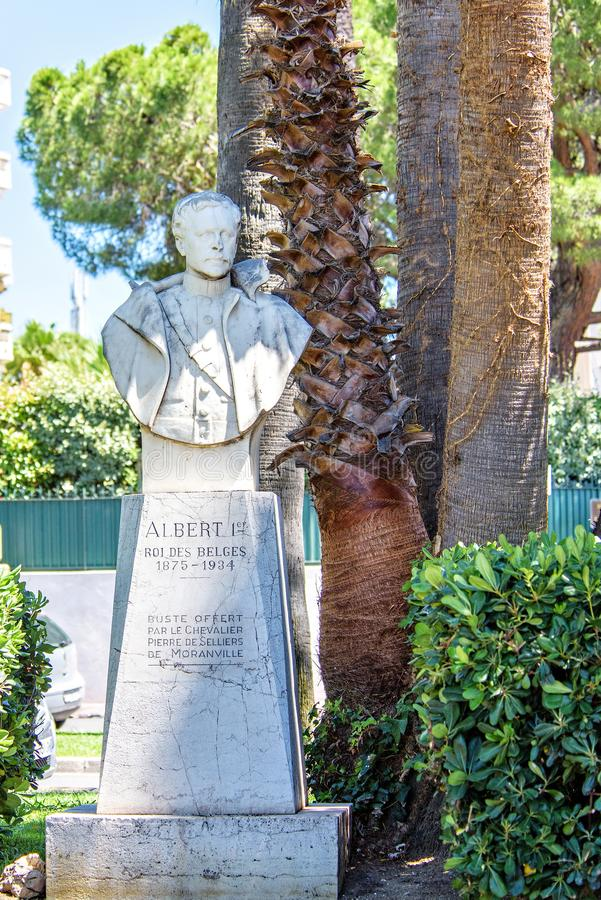 Daylight view to Sculpture of Albert I King of Belgium. CANNES, FRANCE - JUNE 29, 2017: Daylight view to Sculpture of Albert I King of Belgium. Trees and stock photos