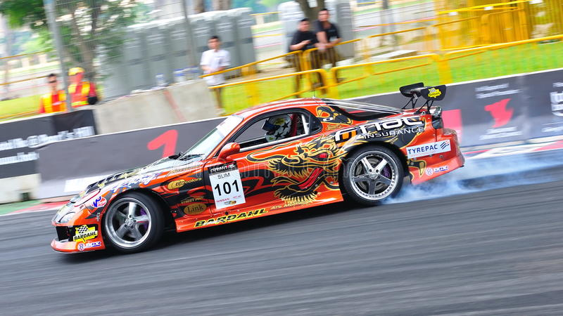 Daynom Templeman drifting at Formula Drift 2010. Daynom Templeman from Goodyear Singapore competing at Singapore Formula Drift 2010 at F1 Pit Building on 24 Apr royalty free stock photography