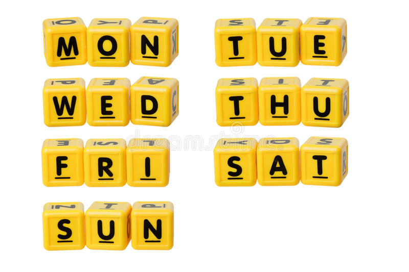 Days of the week. Alphabet blocks forming the days of the week isolated on white background royalty free stock photography