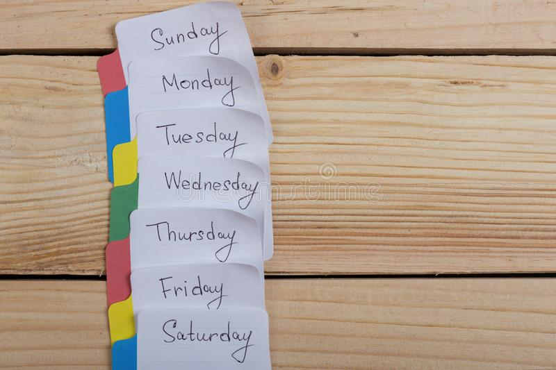 The days of the week - the paper stickers attached to the board is stock images