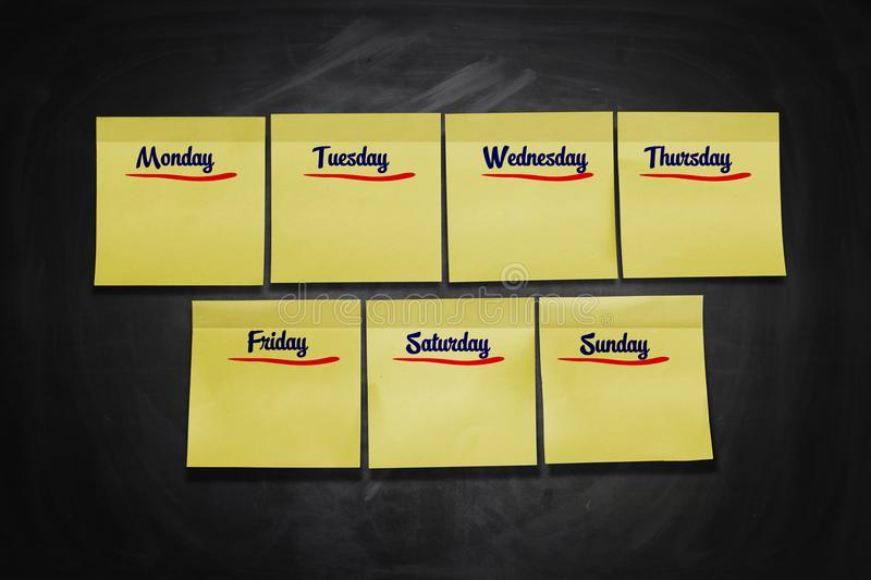 Days of Week Stick Notes. On black board stock photos